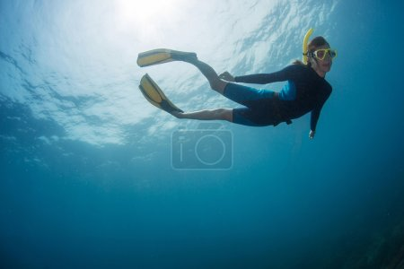 woman freediver in yellow mask