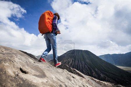 Backpacker walking on an edge