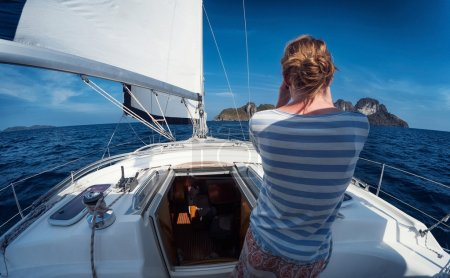Girl standing on the yacht