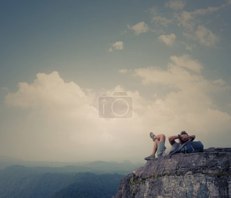 Photo for Hiker relaxing on top of the mountain - Royalty Free Image