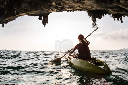 Young lady paddling the kayak
