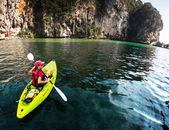 Kayaking near rocks
