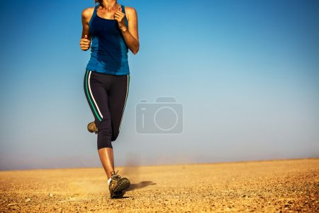 Photo for Lady running in the desert - Royalty Free Image