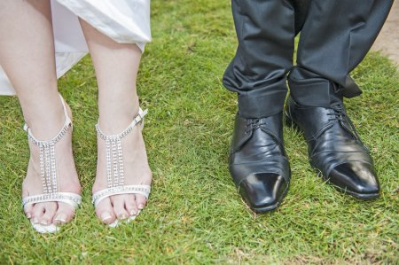 Bride and grooms feet at a wedding