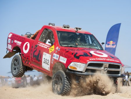 Off-road trucks competing in a desert rally