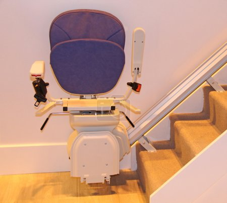 Photo for A Stair Lift in the Folded Position at the Bottom of Stairs. - Royalty Free Image