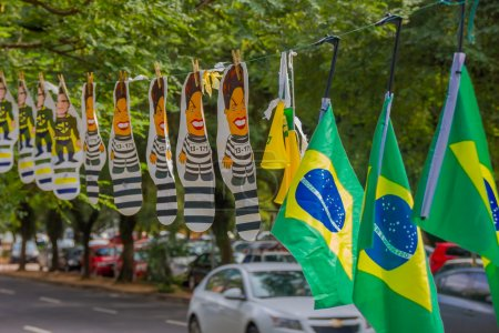 PORTO ALEGRE, BRAZIL - MAY 06, 2016: cartoon of the ex president of brazil dilma rousseff in jail suit next to brazilian flags