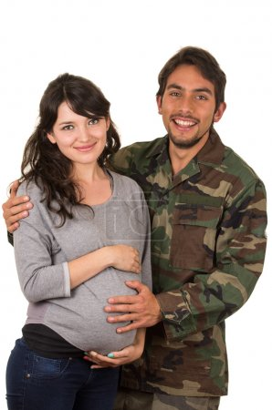 happy proud military soldier hugging pregnant wife