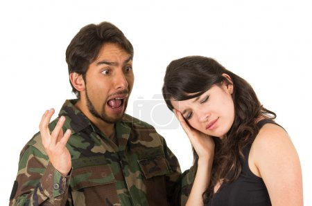 Photo for Distraught military soldier veteran ptsd fighting with wife isolated on white - Royalty Free Image