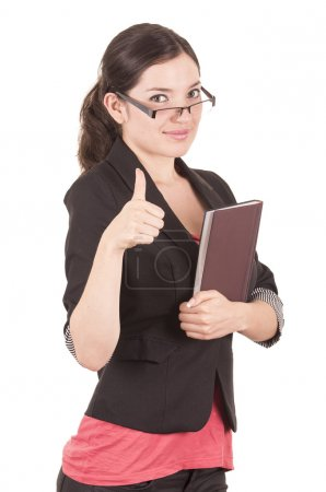 portrait of pretty female teacher wearing glasses and holding book