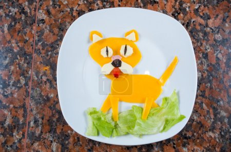 Photo for Animated dog made out of cheese, lattuce and strawberry - Royalty Free Image