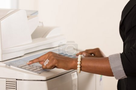 Office woman working copy machine