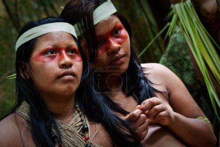 Two young girls from huaorani tribe in the amazon rainforest, Yasuni National Park, Ecuador