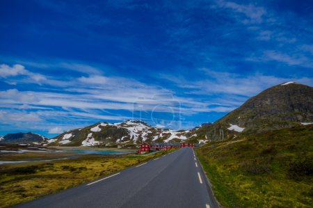 VALDRES, NORWAY - 6 JULY, 2015: Beautiful road passing through Valdresflya mountain range sorrounded by stunning nature