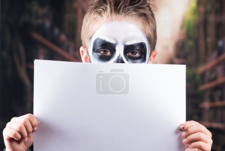 Young boy with skull make up