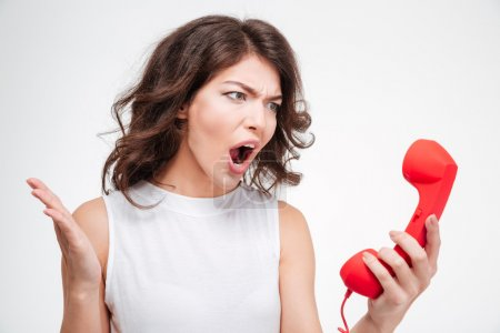 Angry woman screaming on phone tube