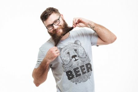 Funny cheerful bearded man standing and having fun