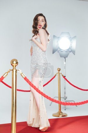 Photo for Charming woman posing on red carpet - Royalty Free Image