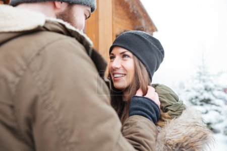 Couple standing outdoors together in winter