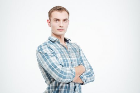 Confident attractive young man standing with arms crossed