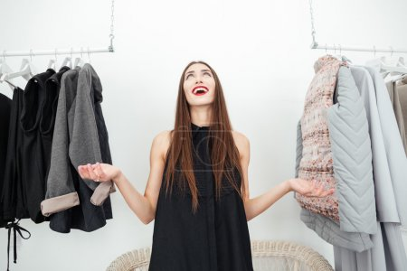 Excited woman standing clothing shop