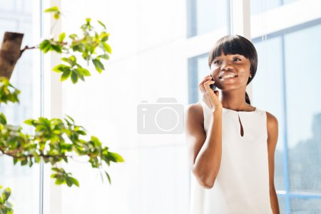 Afro american woman talking on the phone in office