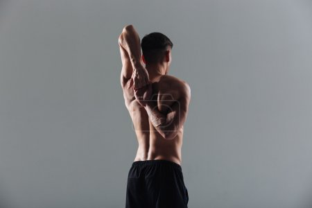 Fitness man stretching hands