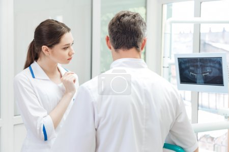 Two dentists discussing medical treatment