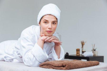 Closeup of beautiful young woman relaxing in spa salon