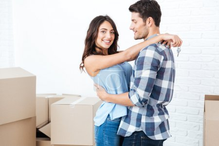 Happy married couple moved in new flat