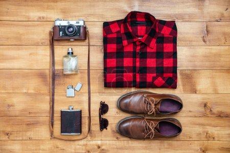 Travel concept shirt, camera, shoes, flask, lighter,eyeglasses,