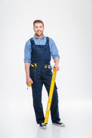 Full length portrait of a smiling male builder