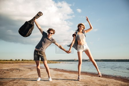 Portrait of a young couple having fun on the beach