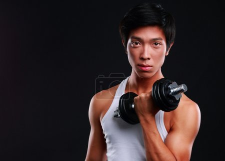 Handsome fit asian man isolated on black background