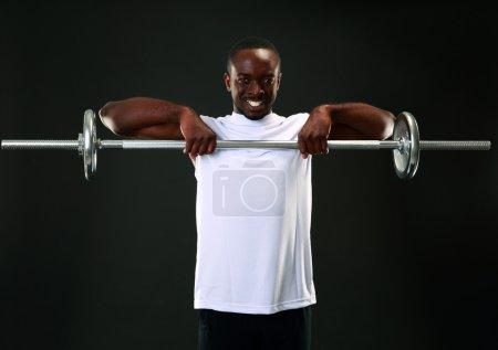 Handsome sports african man over black background