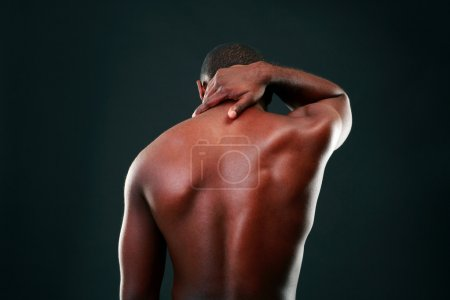 Photo for Back view portrait of african man over black background - Royalty Free Image