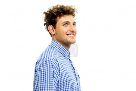 Photo for Smiling man with curly hair looking up - Royalty Free Image