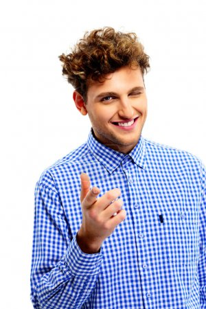 Photo for Smiling man pointing at you over white background - Royalty Free Image