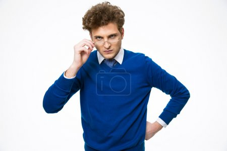 Photo for Dissatisfied young businessman in glasses looking at camera - Royalty Free Image