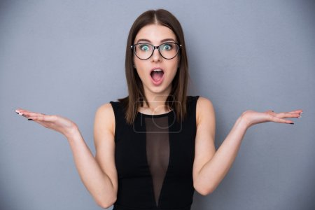 Cute woman with facial expression of surprise