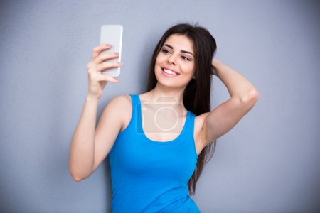 Cheerful woman making selfie photo