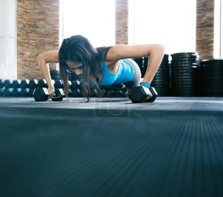 Woman push-ups on the floor