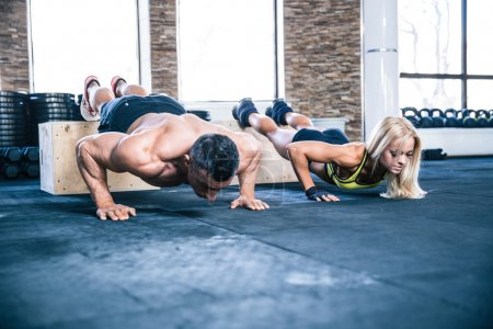 Woman and man doing push ups