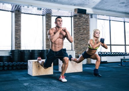 Photo for Woman and man working out with fit box at gym - Royalty Free Image