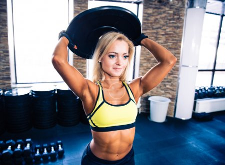 Woman workout at crossfit gym