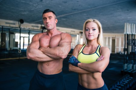Group of a man and woman in crossfit gym