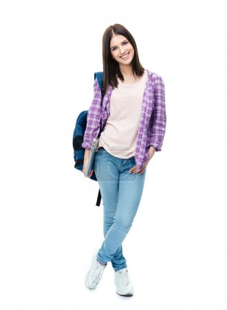 Photo for Full length portrait of a smiling young woman standing with backpack and laptop. Looking at camera - Royalty Free Image