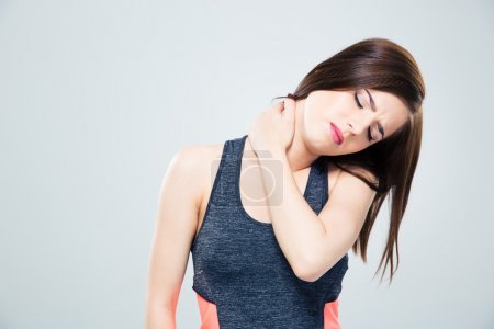 Fitness young woman with neck pain
