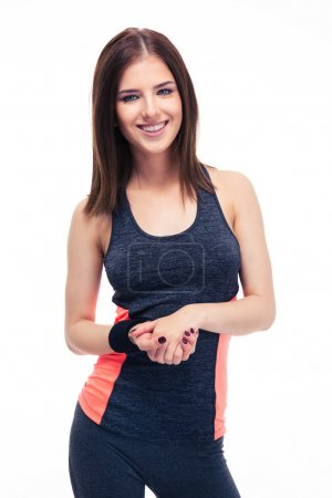 Charming young fitness woman looking at camera