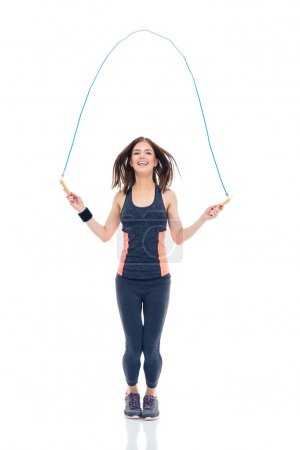 Cheerful woman doing exercises with jumping rope